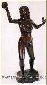 A life-size bronze sculpture of a nude young woman, holding an apple high in her right hand and gazing into it. Her left hand is behind her, palm out, as if to ward something off.